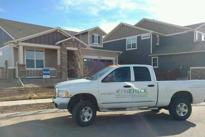 ProCheck truck in front of a residential home
